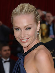Portia's highlighted blonde locks were crimped and styled in a simple ponytail for a textured and classic look.