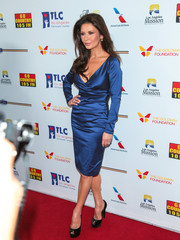 Catherine Zeta-Jones displayed her fabulous figure in a ruched blue satin dress at the Legacy of Vision Gala.