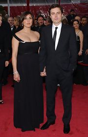 Summer wears a sultry black floor length gown to the Academy awards with husband, Casey Affleck.