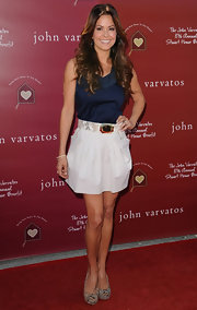 Brooke looks ultra-stylish at the Stuart House Benefit in a silk navy blouse and a high-waisted skirt.