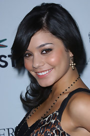 Vanessa Hudgens swept her hair into a loose low side ponytail.