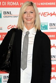 Olivia Newton-John once again pulled off a plaid necktie at the IRFF premiere of 'A Few Best Men.'