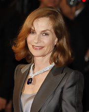 Isabelle Huppert accessorized with a breathtaking gemstone statement necklace at the premiere of 'Precious.'