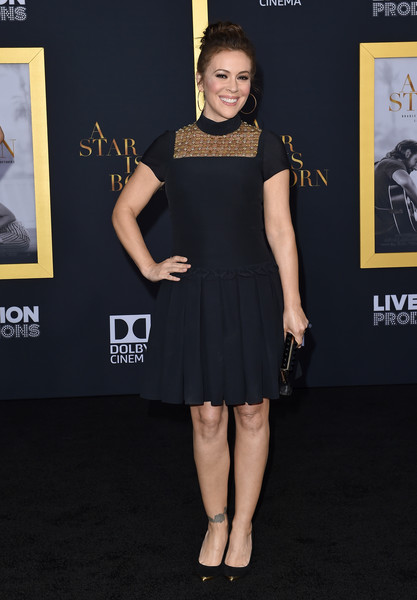 Alyssa Milano donned a little black dress with a pleated skirt and embellished bib detail for the premiere of 'A Star is Born.'