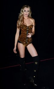 Abbey Clancy looked va-va-voom in gold sequined bodysuit during a fashion show.