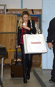 Abbey Clancy left the London Studios lugging a Louis Vuitton rollerboard.