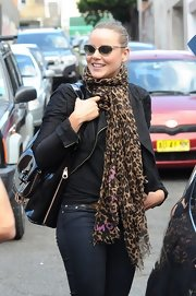 Abbie Cornish's leopard print scarf was the statement of her day look.