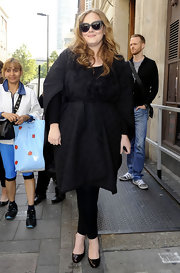 Adele layered up in a black wrap design with a tie waist for her visit to the Radio One Studios.