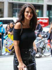 Adriana Lima accessorized with a quilted patchwork shoulder bag for a Victoria's Secret fashion show fitting.