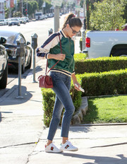 Alessandra Ambrosio added an extra pop of color with a red leather shoulder bag.