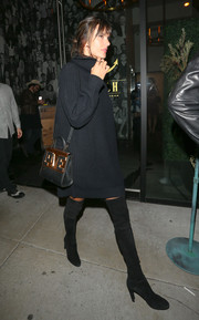 Alessandra Ambrosio was cozy and chic in a black turtleneck sweater dress by Rails while out at Catch.