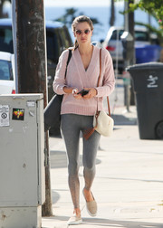 Alessandra Ambrosio was casual and cute in a pink crossover sweater while out in LA.