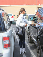 Alessandra Ambrosio headed out for a day of errands carrying a stylish black bucket bag by Mansur Gavriel.