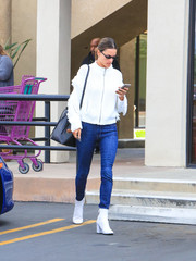 Alessandra Ambrosio paired her sweater with blue skinny jeans by Mother.