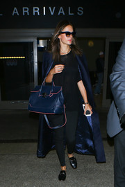 Alessandra Ambrosio completed her airport outfit with a pair of black loafer mules by Tod's.