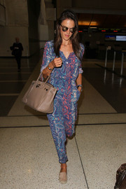 Alessandra Ambrosio looked vibrant at LAX in a multicolored paisley jumpsuit.