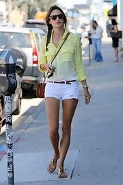 Alessandra's crisp white shorty shorts  complemented her pale yellow top for a super light street look.