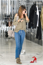 Alessandra Ambrosio was seen out and about looking trendy in a tan cold-shoulder knit top by Vici Collection.