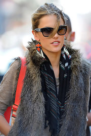 Alessandra paired her fur vest with beaded earrings for an outting in SoHo.