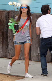 Alessandra bought an orchid in this feather-print tee.