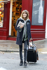 Alexa Chung fought the winter chill in a casual navy fleece coat layered over a contrasting mint green jacket.