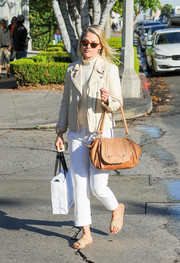 Ali Larter teamed her jacket with loose white capris.