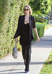 Ali Larter cuffed up the sleeves of her black open front blazer for an effortlessly cool look.