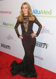 Paris Hilton flaunted her shapely physique in a Michael Costello lace fishtail gown during the Power Up Gala.