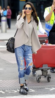 Amal Alamuddin caught a flight at Heathrow wearing a cozy shawl-collar cardigan.
