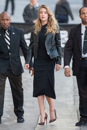 Amber Heard styled her dress with a chic black leather jacket.