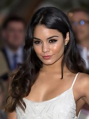 Vanessa Hudgens looked lovely at the Amber Lounge fashion show wearing her long hair in sexy messy waves.