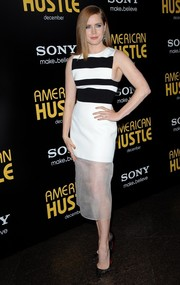 Amy Adams went for a modern vibe at the 'American Hustle' premiere in a David Koma dress featuring a black-and-white striped bodice and a sheer-panel skirt.
