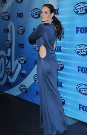 Kara looked elegant in a cutout blue gown with a tight, low ponytail and bold dangling earrings.