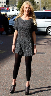 Tara Reid stepped out for a photocall in London wearing a pair of black platform booties.