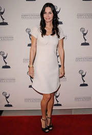 Courteney Cox looked elegant in black satin T-bar peep-toes.