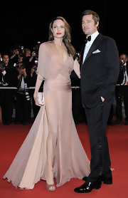 Angelina Jolie embodied Hollywood glamour carrying a dainty blush colored clutch. The purse perfectly complemented her gorgeous gown.