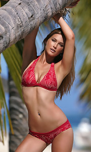 Bar Refaeli models a red halter-top bikini.