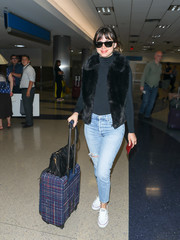 Ana de Armas teamed torn, faded jeans with a black turtleneck for a flight.