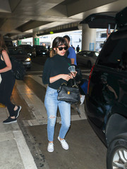 Ana de Armas arrived on a flight at LAX carrying a stylish black satchel.