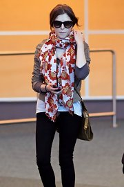 Anna is ready for spring in a vibrant floral print scarf while at YVR.