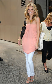 Leaving Regis and Kelly, Annalynne is in a baby pink strapless top with white jeans. Her shoes are leather with a decorative snake. They work well with her top because they are colors that complement each other.