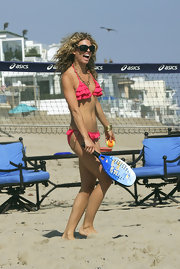 AnnaLynne McCord was happy to be in the spotlight -- on the beach in this bright pink ruffled string bikini.