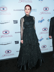 Priscilla Presley made a glamorous appearance at the Brent Shapiro Foundation Summer Spectacular in a black-and-white star-print ball gown.