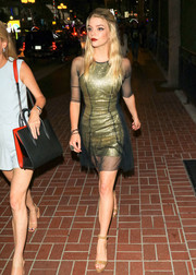 Anya Taylor-Joy was spotted at San Diego Comic-Con 2018 looking chic in a gold dress with a sheer black overlay.