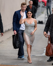 Ariel Winter put on an eye-popping display in a sheer, body-con silver dress by Meshki while headed to 'Kimmel.'