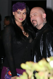 Tera Patrick wore a purple fascinator to the Armani Exchange watch launch.