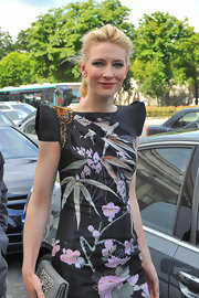 Cate shows her admiration for Armani in a black floral print dress and a beaded clutch.