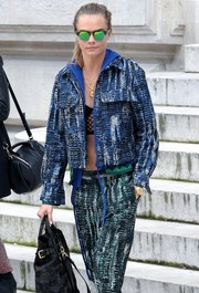 Cara Delevingne sported bright green lenses during Paris Fashion Week.