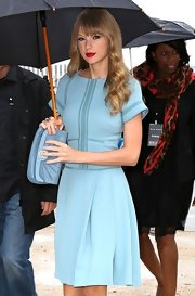 Taylor Swift was feeling the blues, pairing her baby blue frock with a light blue leather clutch.
