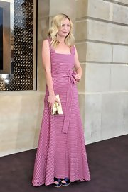 Kirsten Dunst looked ultra-girly in this floor-length pink polka-dot dress at the Louis Vuitton show.